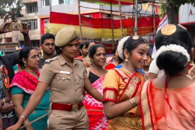 Police and Dancers are on Duty during Kapali Festival
